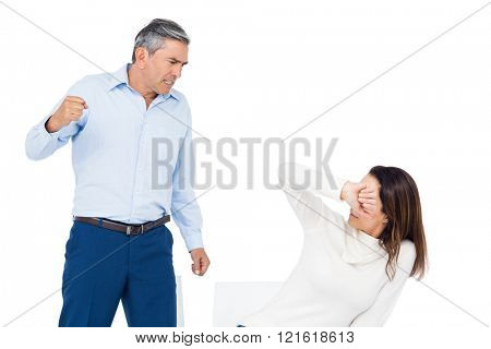 Angry man about to hit his wife on whitebackground