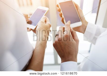 Women is holding mobile phone with blank copy space screen for your text message or content