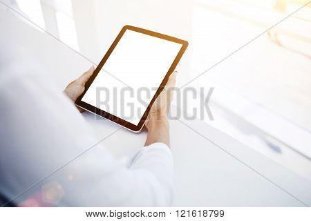 Female is watching news in web on digital tablet