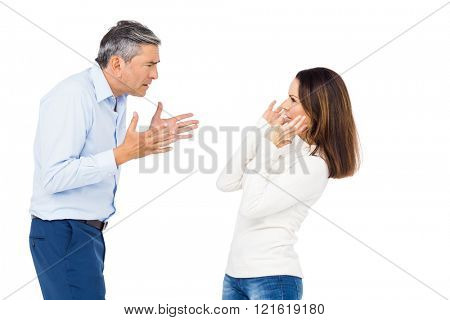 Annoyed man yelling at wife against white background