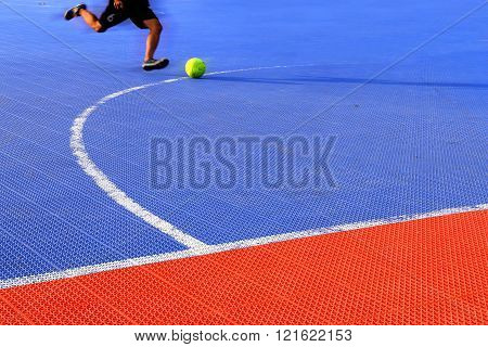 Man Kicking Football On Ground Futsal.