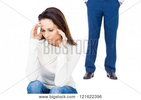 Angry couple ignoring each other against white background