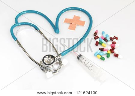 heart shape of stethoscope with medical equipment and medicine