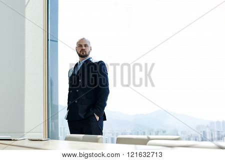 Young successful businessman is posing during work day