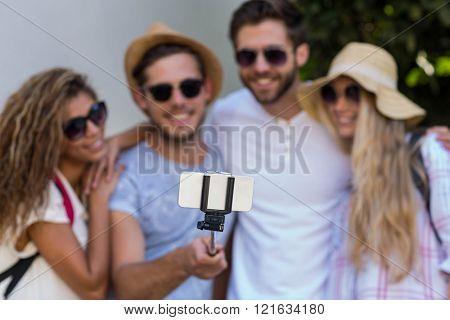 Hip friends taking selfie on the street