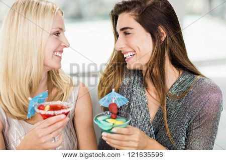 Close-up of beautiful women smiling and having mocktail