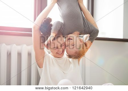 Happy family. Mother and son playing and smiling. Little boy having fun with his mother at home