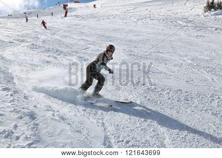 Woman skiing in ski resort in Austria - Bad Gastein in High Tauern (Hohe Tauern) mountain range in Alps.