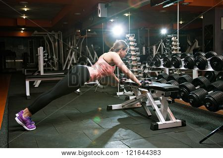 Fitness Woman Doing Push Up In The Gym