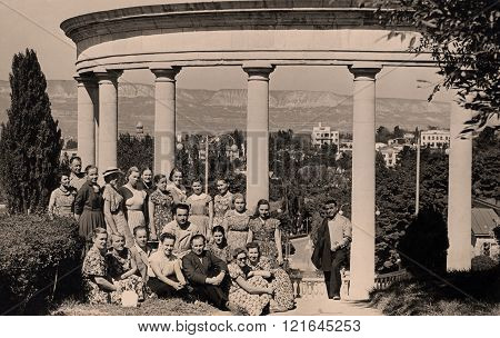 KISLOVODSK,RUSSIA - JUNE 18,1951:Vintage group photo portrait  of russian tourist.Group people in front of Colonnade in Kislovodsk,Caucasus,Russia on June 18,1951.