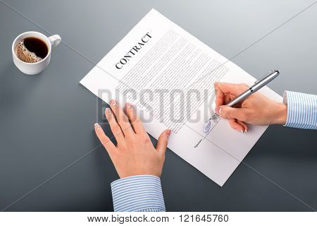 Female manager signing contract.
