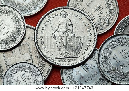 Coins of Switzerland. Standing Helvetia depicted in the Swiss two franc coin.