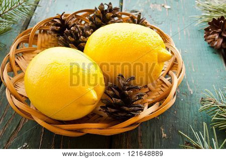 natural Christmas decor of pine cones and lemons