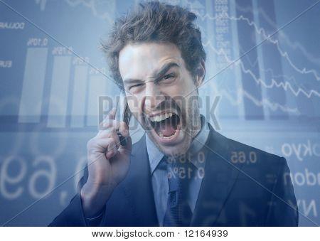 Stock exchange broker screaming to telephone