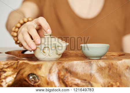 Close-up Wooden Table For The Tea Ceremony Utensils On Tea Master Background At Home