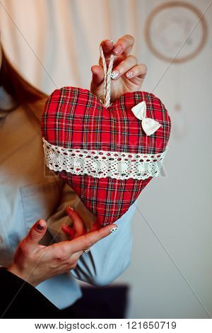 A Girl Holds A Toy Red Heart