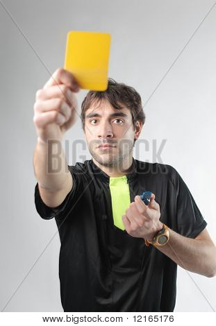 Referee showing a yellow card