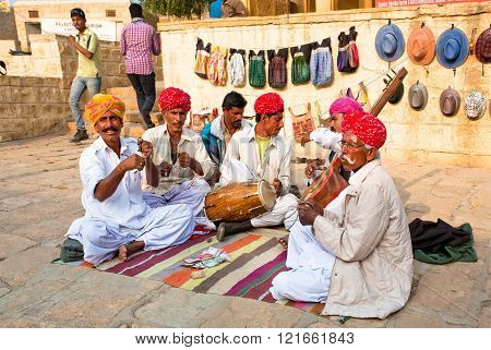 JODHPUR, INDIA - JAN 28: Emotional musicians play indian music on different instruments outdoor on January 28, 2015 in Rajasthan. Jodhpur with population 1290000 people is center of Marwar region
