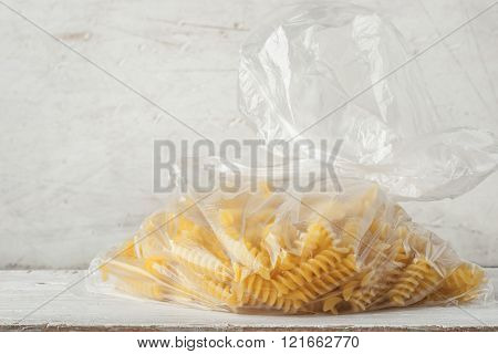 Pasta on the cellophane package background horizontal