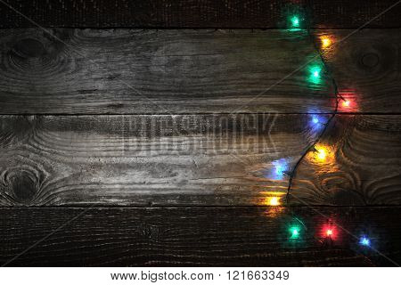 Colorful festoon at the right of the wooden board