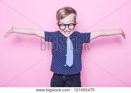 Stylish boy in shirt and glasses with big smile. School. Preschool. Fashion. Studio portrait