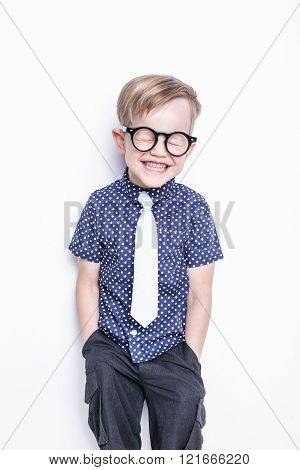 Portrait of a little boy in a funny glasses and tie. School. Preschool. Fashion. Studio portrait