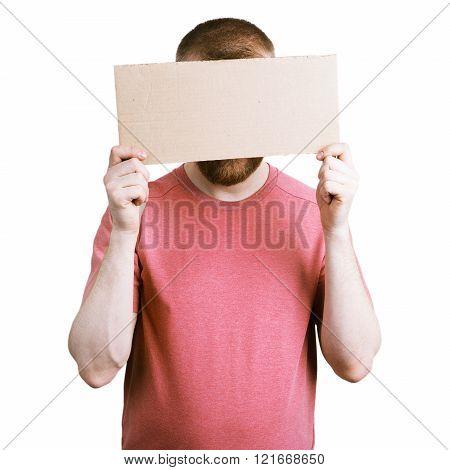 Man Holding A Cardboard Sign