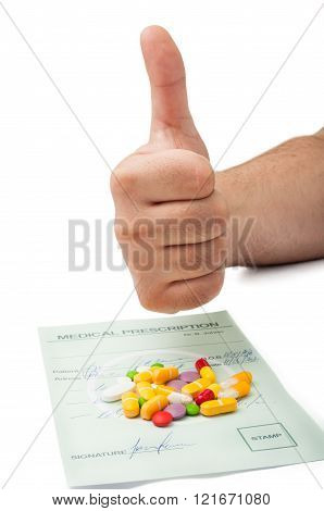 Hand Showing Thumbs Up Above A Medical Prescription