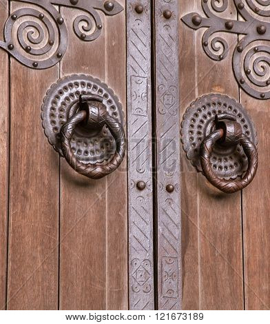 Iron ring on a wooden door of a cathedral