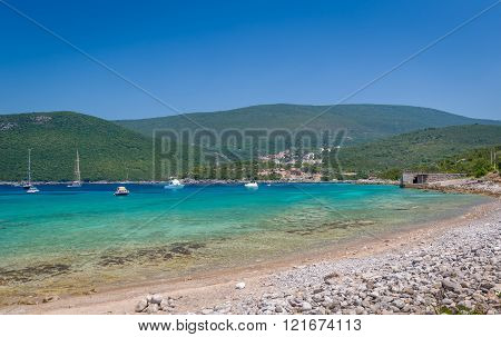 Beautiful bay of Adriatic sea with recreational boats at anchor