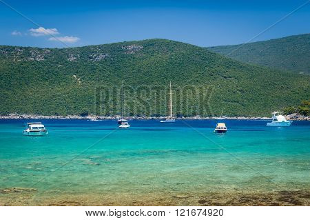 Recreational boats and yachts at anchor in a beautiful calm bay with dreamy water