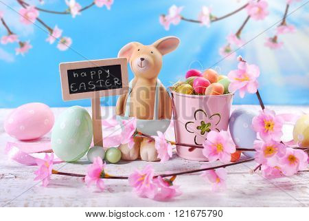 Easter Card With Clay Rabbit  And Decorations On Sky Background