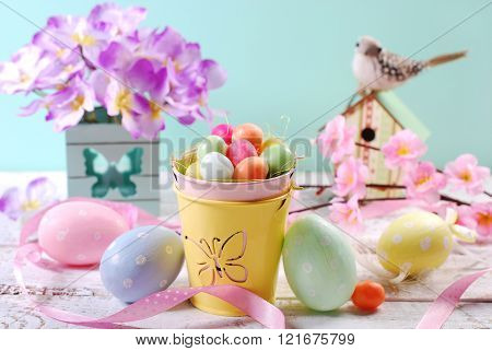 Easter Pastel Colors Decoration With Candy Eggs In Small Bucket