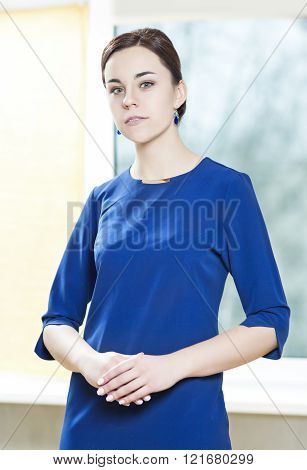Nice Portrait Of Sensual Woman In Elegant Blue Dress. Posing Indoors.