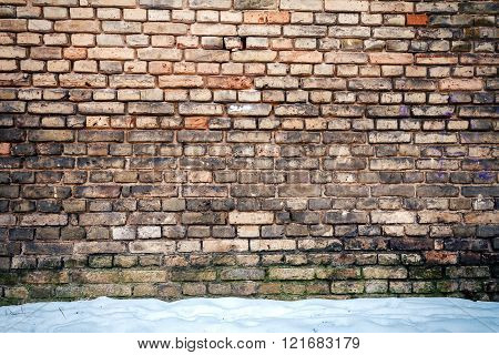 Yellow Brick Wall And Snow