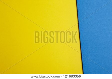 Colored Cardboards Background In Yellow Blue Tone. Copy Space