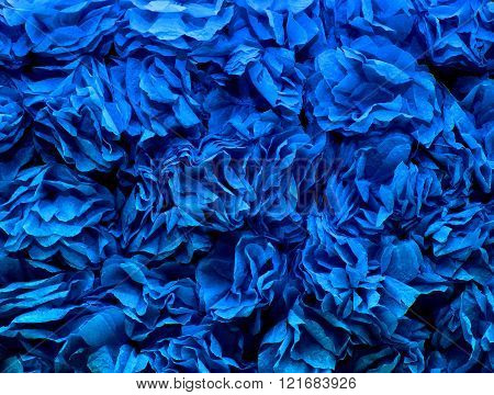 background of blue flowers made of crepe paper