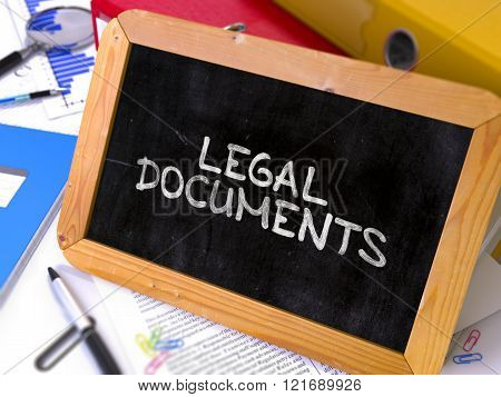 Hand Drawn Legal Documents Concept on Small Chalkboard.