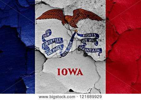flag of Iowa painted on cracked wall