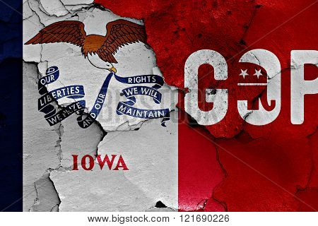 flag of Iowa and gop painted on cracked wall
