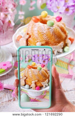 Taking Photo Of Easter Ring Cake By Smartphone