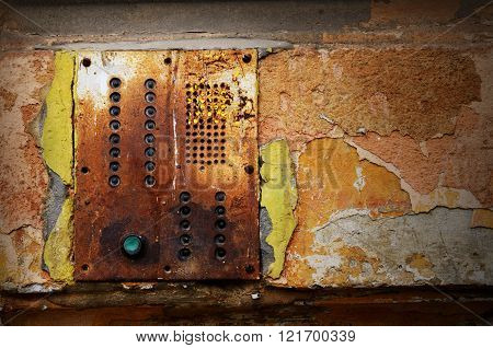 Dramatic grunge old wall with intercom panel buttons background for your retro design