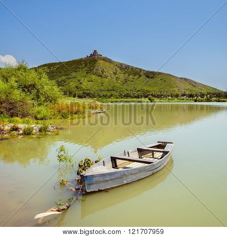 Beautiful Boat In Water On Mountain Background