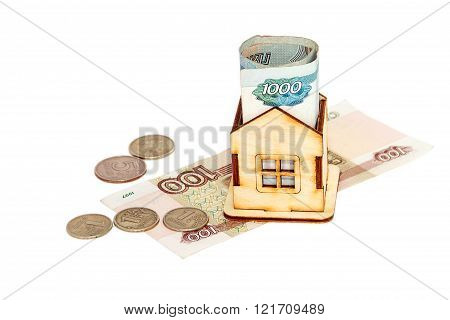 House And Money On A White Background