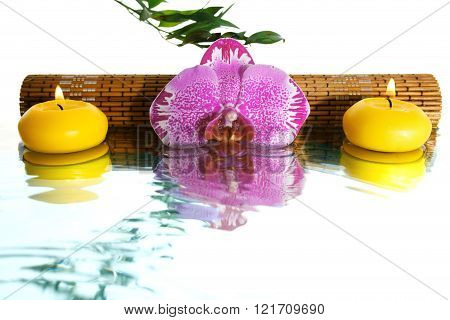 Orchid And Aromatic Candles With Reflection