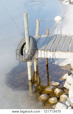 One Small Rural Wooden Bridge And Melting Ice