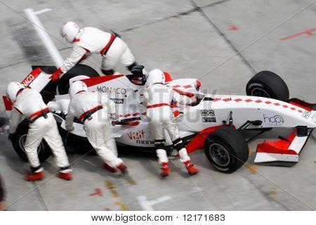 Sepang, MALAYSIA - 23 November: Team Monaco pushing cars into the pits at the World A1 GP championship races held in Malaysia. 23 November 2008 in Sepang International Circuit Malaysia.