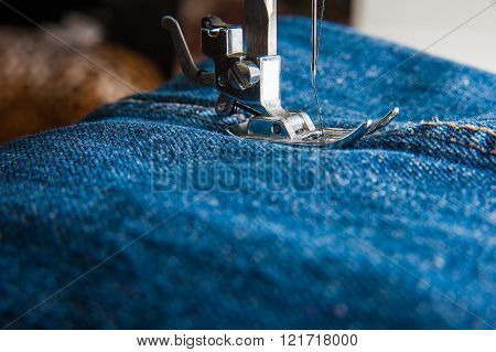 Foot Of Sewing Machine On Jeans