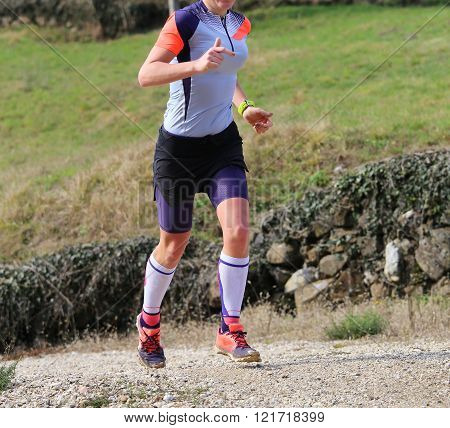Runner With Sneakers Fast Runs On Country Road During The Cross Country Championships