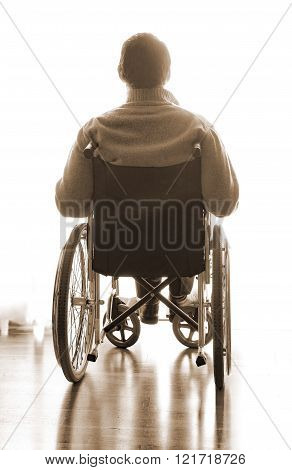 Disabled Sitting In A Wheelchair In The Room